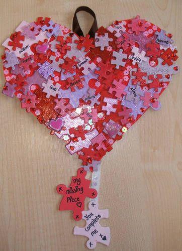 Cuadro forma corazón con piezas de puzzle
