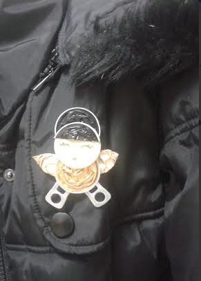 Broche de muñeca con nespresso y chapas