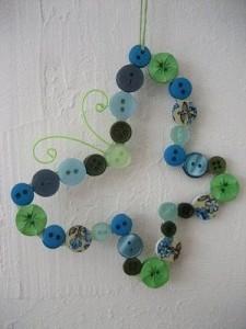 Decoración para bebés con mariposas de botones