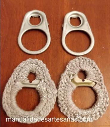 Materiales para pendientes de chapas de conservas